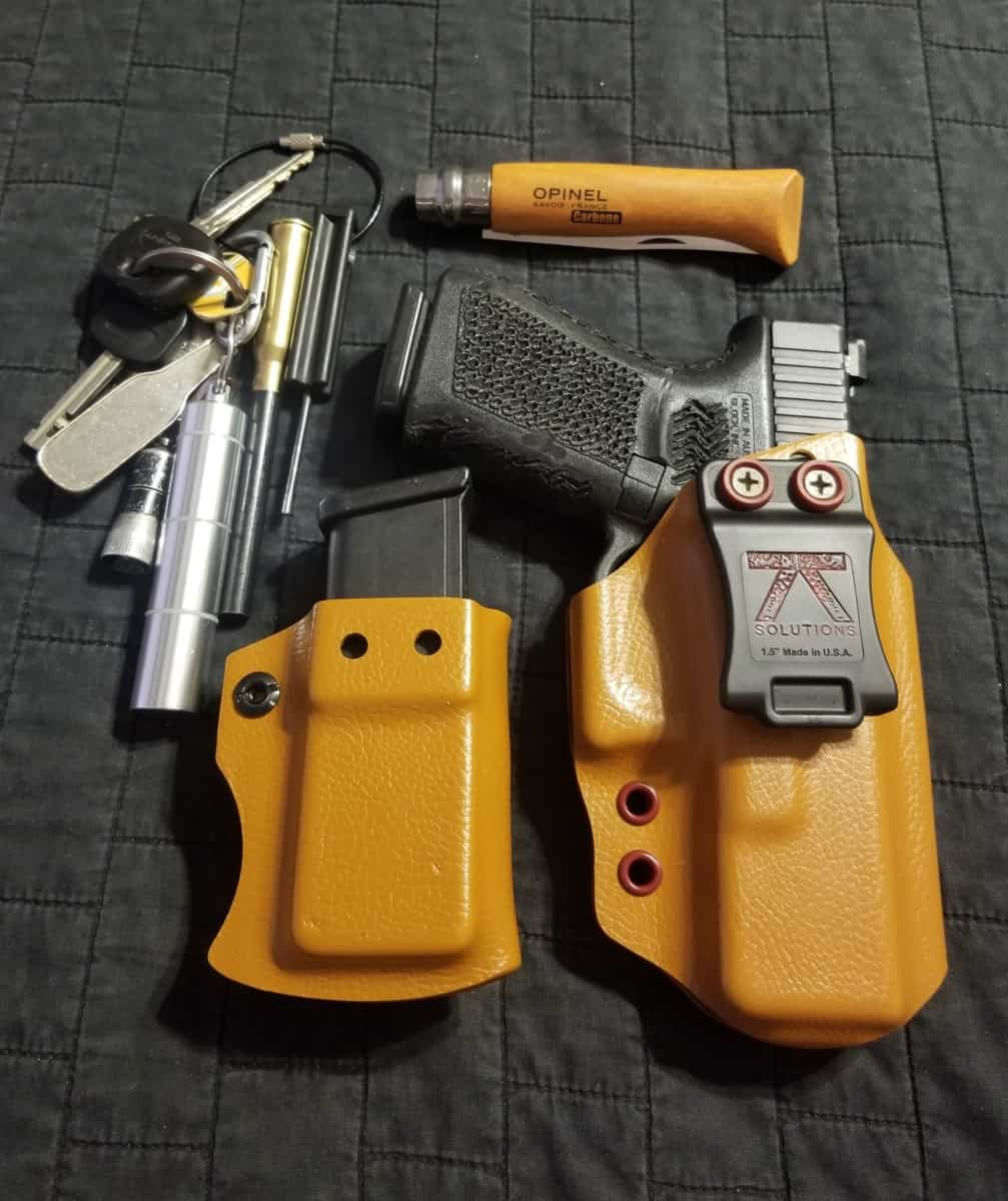 Handgun holsters by 77 Solution EDC